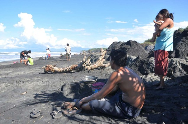 In this file photo taken in 2012, the beaches of Barangay (village) Villa Leonora in Buguey, Cagayan are dotted with villagers trying to eke out a living from scooping blacksand and sell this to foreign mining companies operating in the area. This time, mining companies are eyeing to mine the seabed in the off-shore areas of the town, through a mining permit issued in 2010 by the Mines and Geosciences Bureau.