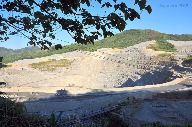 The open pit of the gold-copper project has left a gaping hole at the center of Didipio village in Kasibu, Nueva Vizcaya. Photo by Melvin Gascon